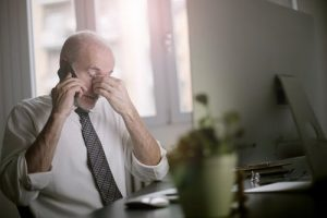 stressed man on the phone