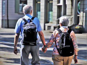 seniors walking holding hands
