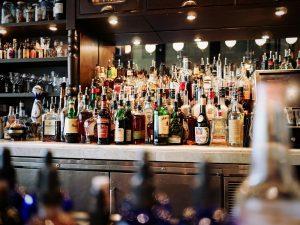 alcohol bottles behind bar