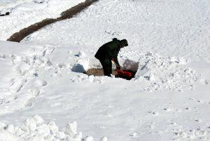 man shovelling