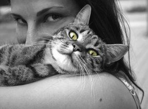 woman hugging cat