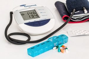 blood pressure monitor and pills