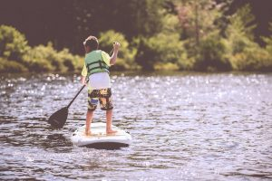 young child on sup
