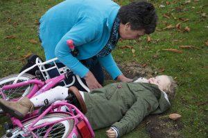 adult assisting injured child