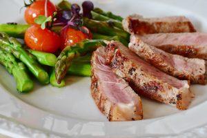 Healthy meal with asparagus and lean pork
