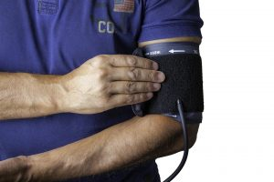 Man with blood pressure monitor on his arm